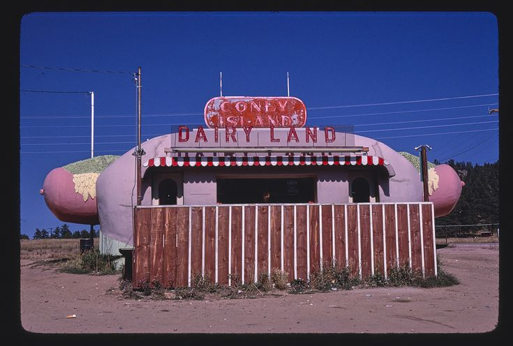 Margolies, John,, photographer.  Coney Island Dairyland, end detail, Route 285, Aspen Park, Colorado  1980.  1 photograph : color transparency ; 35 mm (slide format).  Notes:  Title, date and keywords based on information provided by the photographer. Margolies categories: Mimetic buildings; Eating & drinking establishments: (roadside and Main Street). Please use digital image: original slide is kept in cold storage for preservation. Credit line: John Margolies Roadside America photograph...