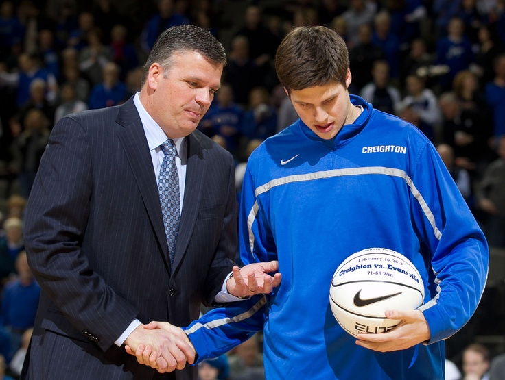 Creighton head coach Doug McDermott presents his son, Doug McDermott, with a ball commemorating his 2,000th career point, scored while on the road against Evansville on Feb. 16, 2013, before the game as Creighton hosted Southern Illinois at the CenturyLink Center.  By: MARK DAVIS/THE WORLD-HERALD