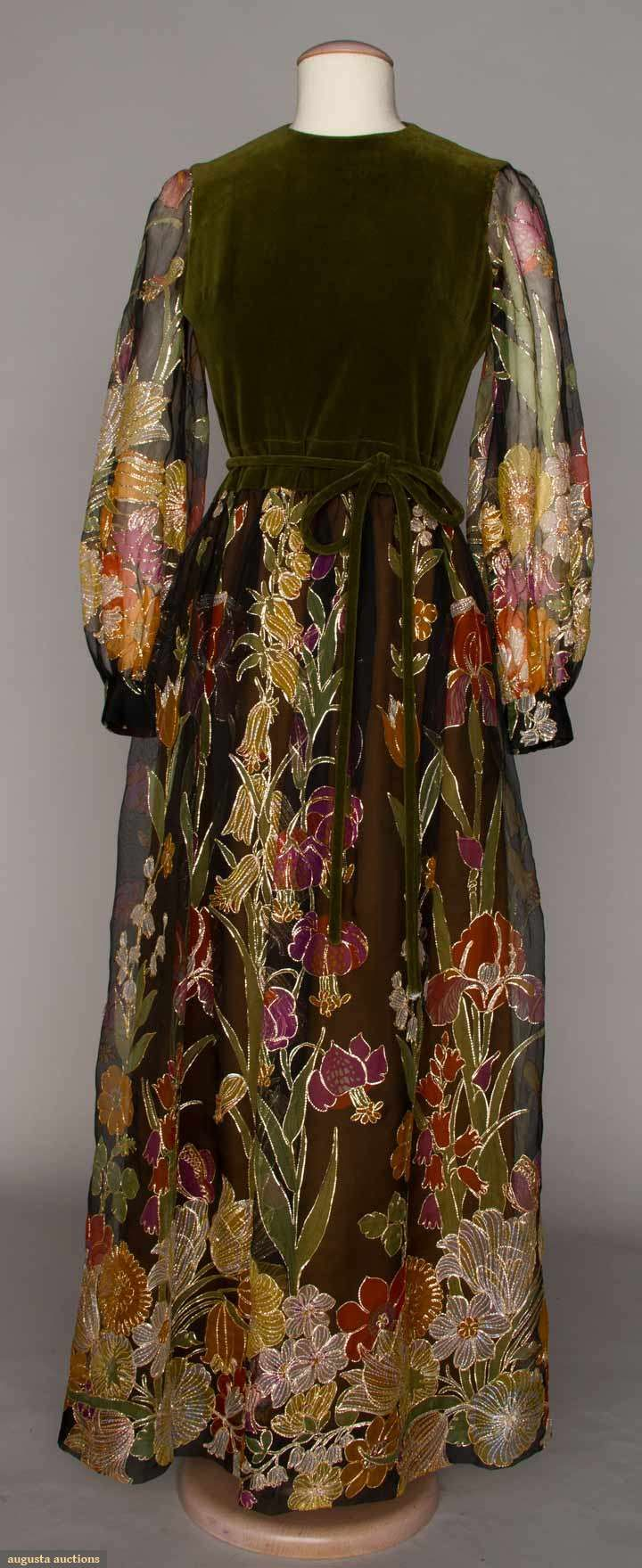 """Label """"Diorling by Christian Dior London - """"MAID MARION"""" DRESS, 1976. Olive green velveteen top & tie belt, sleeves & skirt of sheer dark brown silk printed w/ vertical rows of garden flowers in fall shades, each element outlined in gold thread."""