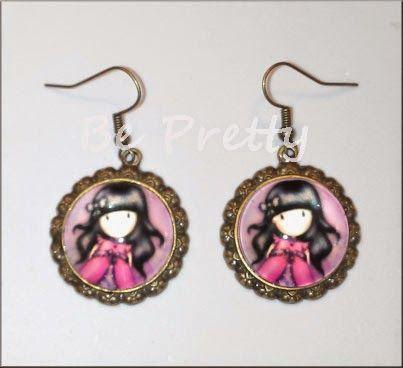 Brincos de cor cobre com medalhões Gorgeous em tons rosa.