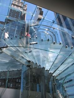 NYC Apple Store - Spiral Glass Staircase Wrapped Around Elevator