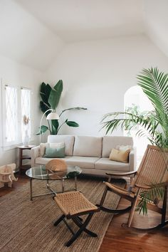 Love so much about this living room - the sofa - the large plants and the texture of the arm chair and the jute rug