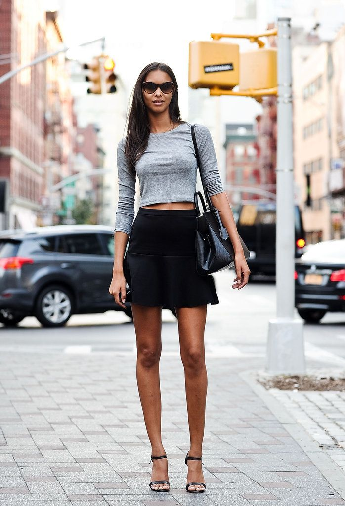 Lais Ribeiro wearing a Topshop top, a Mango skirt, a Louis Vuitton bag, Ralph Lauren sunglasses, and Prada shoes.