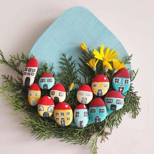 This one is actually pretty cute. You can create some little houses on your rocks and then add them on a plywood you have also painted. You can add some designs like plants and flowers which gives the effect of a village for gnomes or dwarves.