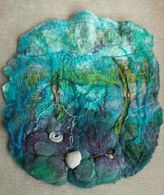 This small felt rock pool wall hanging is made from wool felt with hand and machine embroidered details. Blyth Whimsies