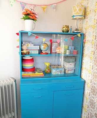lovely old cabinet, painted blue, on the back sticky plastic in blue gingham - so very pretty, would be great on the left wall in my sewing room