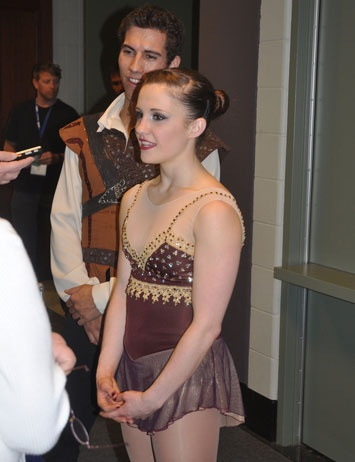Paige Lawrence, with Rudi Sweigers behind her at Four Continents