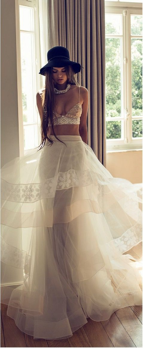 With 90's favourites abound in the fashion industry its no surprise that the crop top has emerged as a favourite trend in the 2017 Bridal Look Book. Showing  a little bit of mid riff is not a taboo and adds a playful, easy going style to your wedding day.