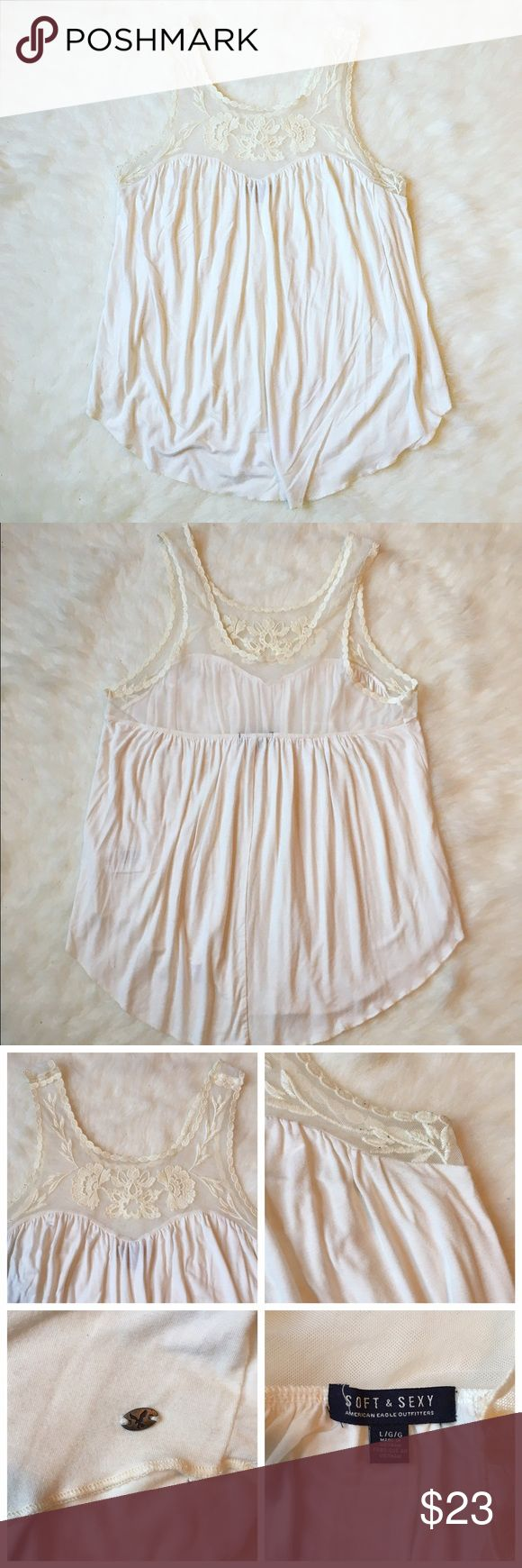 American Eagle fashion tank This is an American Eagle outfitters fashion tank top. It is a gorgeous white tank with beautiful lace. ONLY WORN ONCE! 💞💞💞🚫NO TRADES🚫 American Eagle Outfitters Tops Tank Tops