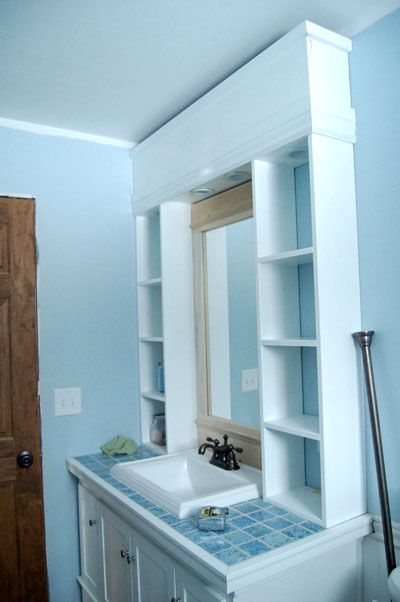 I want to make this!  DIY Furniture Plan from Ana-White.com  How to fancy up a builder grade mirror. Completed mirror can be mounted on any wall. Shown in a custom vanity hutch.