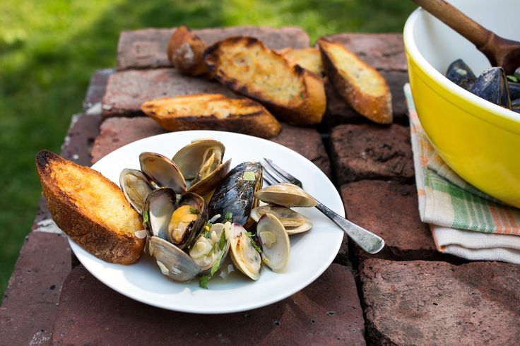 Grilling clams and mussels gives them a smokiness you can't get inside on your stove Use hardwood charcoal if you can; it gives the best, smokiest flavor The cooking time may vary depending upon your grill and the temperature of the shellfish when you put it in the pan