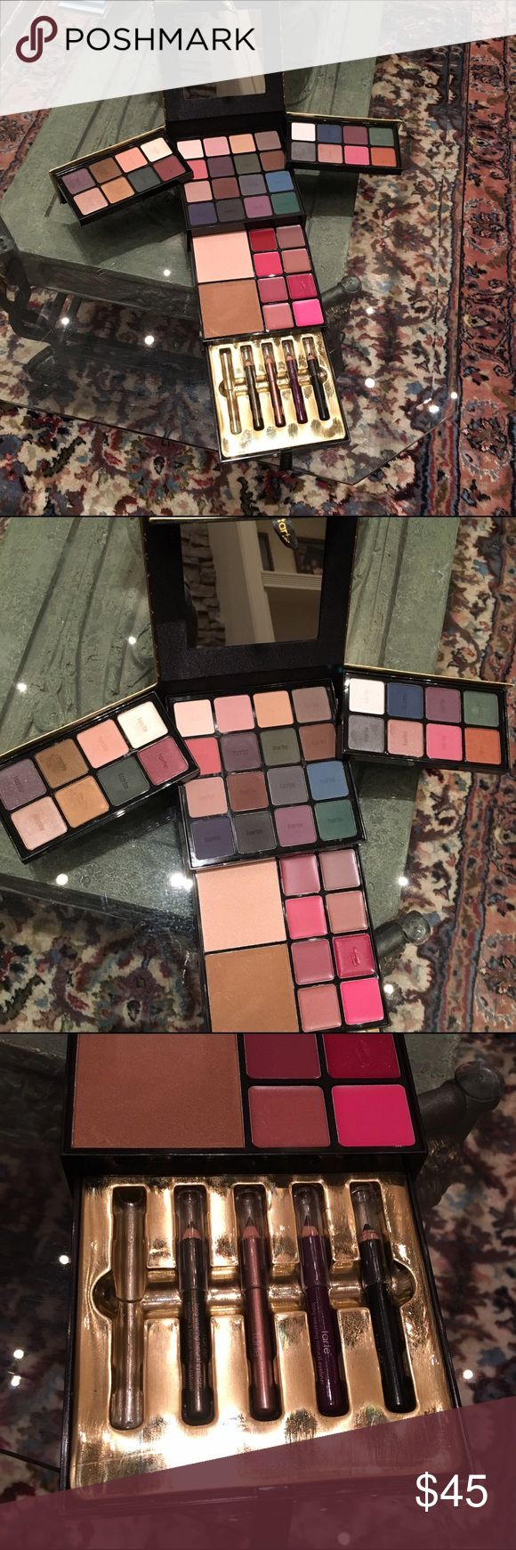 Tarte holiday palette Tarte holiday palette. So many ultra smooth shadows and lip creams! Only flaw is small dent in one of lip shades and missing one eyeliner. Some of the shades were swatched but relatively unused. tarte Makeup Eyeshadow