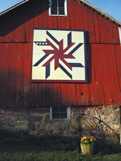 The patriotic quilt block brings attention to Laurie Engen's  historic barn.