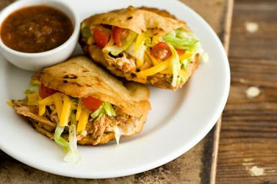 """Chicken Gorditas {Homesick Texan}  """"..you can stuff gorditas, which in Spanish translates to little fat ones, with just about anything. And in Texas, you'll most commonly find them stuffed with meat, cheese, iceberg lettuce, and tomatoes. Basically, it's your traditional crispy taco fillings sandwiched between a thicker, slightly crisp round shell."""""""