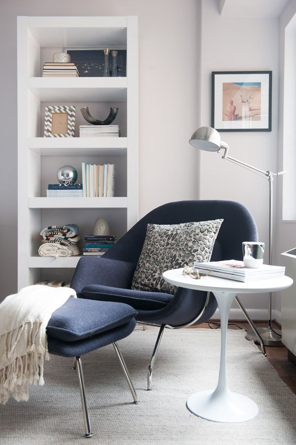 White interior and a grey chair