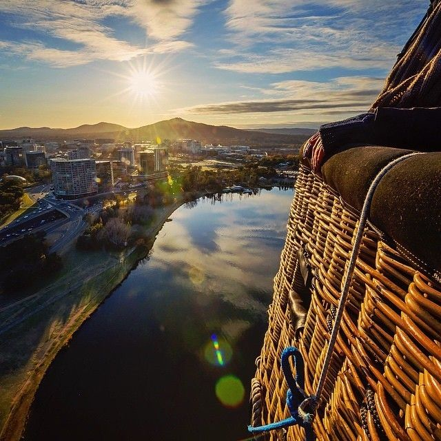 Rise early on your next trip to Canberra and take to the skies in a hot air balloon as the early morning sun fills the valley and floods the lakes with soft morning light. Enjoy the serenity as you drift above the national capital, sealing the experience with a Champagne breakfast just as the rest of the city is starting to come alive. Photo by professional Instagrammer @laurenepbath with @BalloonCanberra. #visitcanberra #seeaustralia