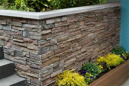Photo: Kolin Smith | thisoldhouse.com | from How to Clad a Wall in Stone. Wonder if you could use the panels to create a planter around the mailbox?  Stone-veneer panels:  Versetta Stone Ledgesonte in Terra Rosa finish $27 per panel; boralameican.com