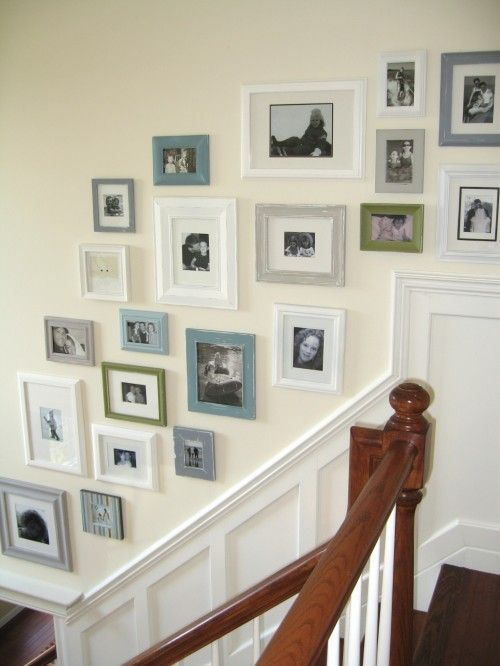 Photo arrangement on stairs. I love all the color in the frames. I may just have to buy a few cans of spray paint to use whatever frames I find and get this set up sometime soon.