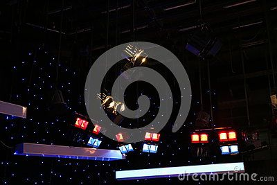 Lighting equipment of TV studio - grid lights inside the TV studio.