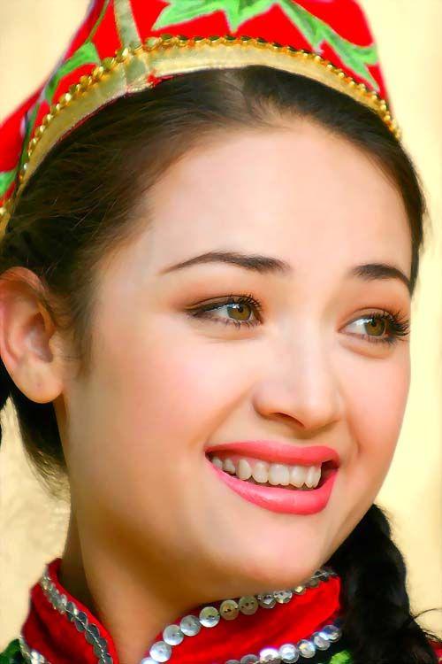 Uyghur woman, China.