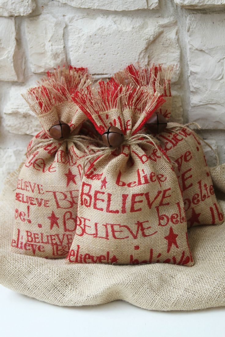 painted burlap bags, tied with twine + bells~