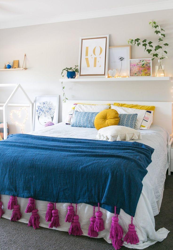 love the tassel blanket in this eclectic Romantic bedroom