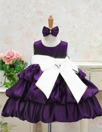 Latest baby girl party wear painted in purple, its look is further enhanced with the big white bow that will go round the waist. Let your newborn come out of her closet and try this on from our available for sale online store.