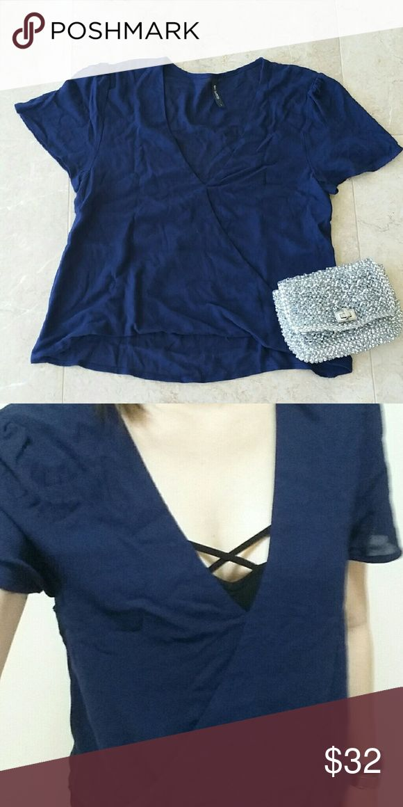 Dark navy short sleeve top Brand new and never worn dark navy short sleeve top.  Material is 100% Rayon. The front is a little short so might be best to wear a camisole underneath. Top is double layered so fits comfortably. on Twelfth Tops Blouses