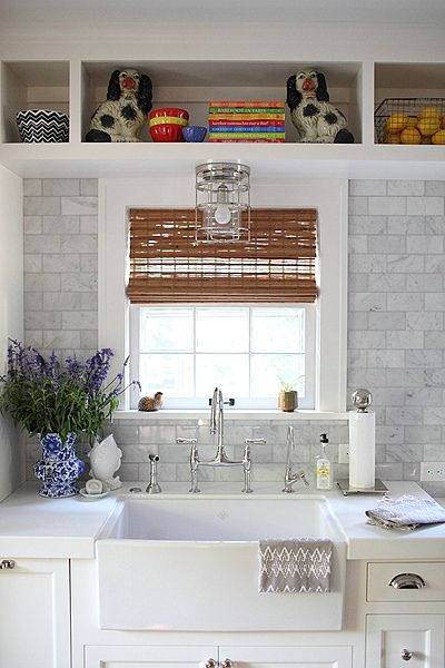 ... Unexpected Addition Of Staffordshire Spaniels, A Blue And White Vase  And The Fish Jug To This Kitchen With White Cabinets And Carrara Marble  Backsplash.