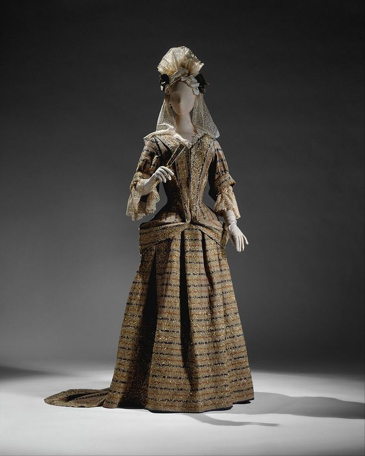 The mantua from Kimberly Hall is of fine striped woolen fabric with silver-gilt embroidery, ca. 1690-1700.