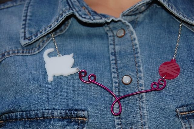 kitty playing with yarn - acrylic necklace in an outfit post