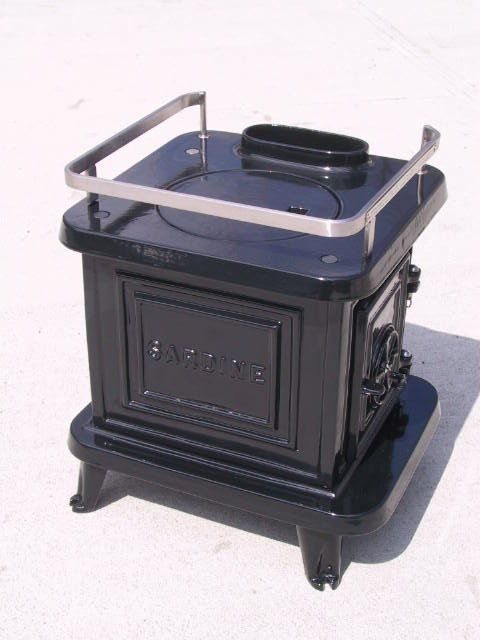 "The tiniest, cast iron wood stove going (12""x12"")!  Enamel finish-made for boats.  Over 85% efficient.  Besides, it is the cutest thing ever!"