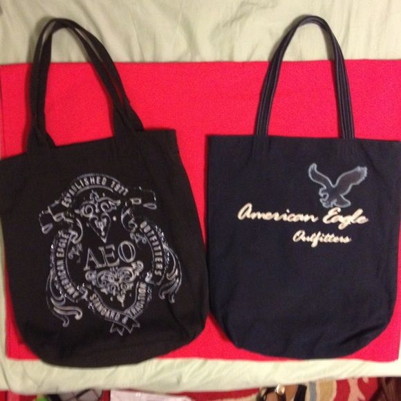 🎉Bundle two AE tote bags!🎉 Two large tote bags one black one navy blue. Navy blue one has a clasp but black doesn't have anything to close it. Both have pockets on the inside. Both pre-loved and have some signs of wear. Navy Blu has some signs of wear  on the bottom but both in great condition. American Eagle Outfitters Bags Totes