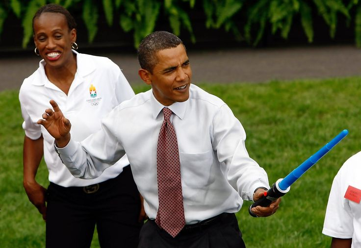U.S. President Barack Obama jokingly jousts during a fencing demonstration on the South Lawn of the White House promoting the city of Chicago?s bid for the 2016 Summer Olympics September 16, 2009 in Washington, DC. Obama joined Chicago Mayor Richard Daley, members of the USOC, and representatives from the Chicago2016 group during the event. Also pictured (white top) is Olympic athlete Jackie Joyner Kersee.