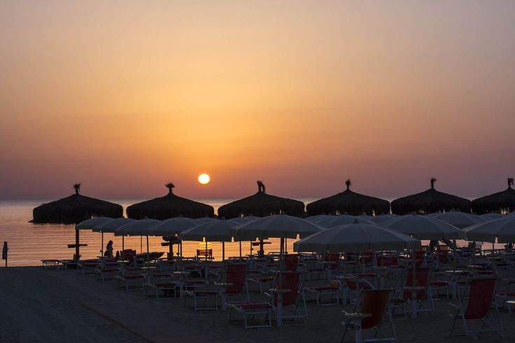 Sunrise on the beach by Giuseppe Mosca on 500px