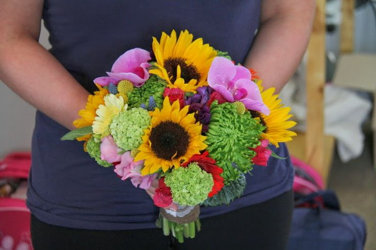 Sun Flowers, Roses, Gerberas, Craspedia, Sweet Peas and Viburnum Opulus