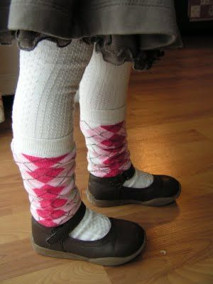 I love little girls in leg warmers. This is a pair of women's socks with the foot cut off and then sewn on the bottom. SO much cheaper than buying kids' leg warmers