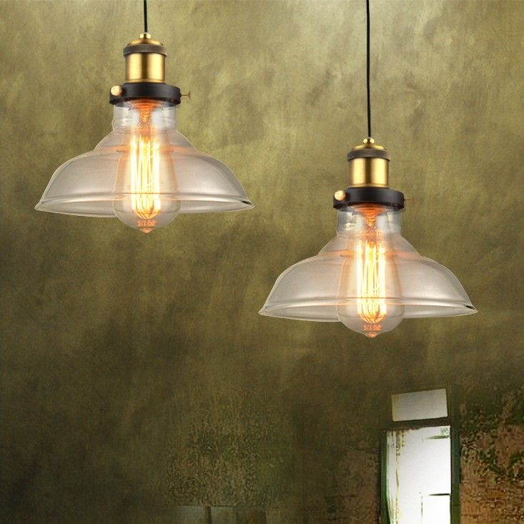 This retro pendant light from Rotar series is inspired by vintage industrial lighting. Simple design includes an inverted flat bowl shade made of clear glass hung from a black wire, attached to a round ceiling canopy. This handsome ceiling light fixture includes 4.3 feet of wire to allow you to choose the optimal hang height for your ceiling.