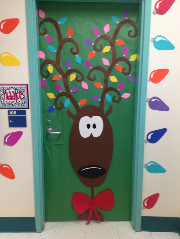 "Christmas door decoration | Perhaps create ""ball ornaments"" with books on the inside to hang from antlers."