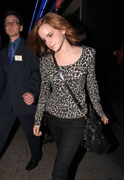 """Emma Watson Scoopneck Sweater"" -   Emma looks fierce in a strong-shouldered, leopard-print top with skinny black jeans."