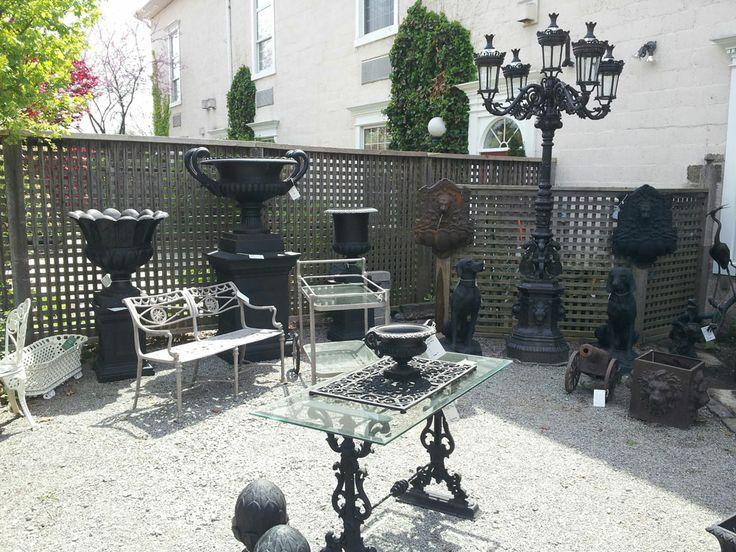 large cast iron urn on pedestal base, large cast iron light post with 5 lights