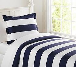 PBkids. One bed with navy stripe, other bed with gray stripe, then add orange sheets to both with printed custom pillow.