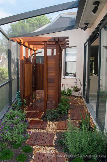 Think about what's underfoot. No one wants to stand around in slime or muddy grass in an outdoor shower. Ipe stands up to water in the shower here, and the teak stepping stones provide an easy path back indoors. UPDATE: used IKEA outdoor flooring tiles