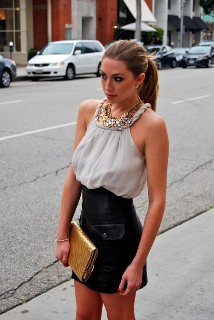high waisted skirt with a billowy shirt to create a defined waist