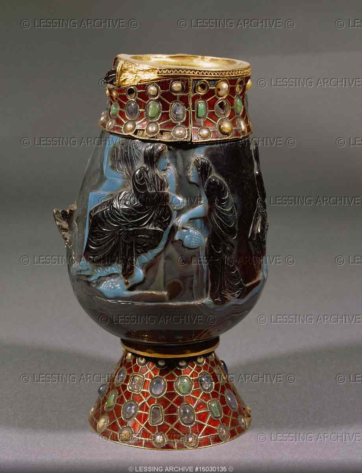 MEROVINGIAN RELIQUARY 6TH  Vessel made of one large sardonyx-gem, of antique but unknown origin (Rome,Alexandria?).Even the scene,a hero with chariot,an old man,grieving women,is unidentified; perhaps Phaidra and Hippolytos. Mounting from the time of Dagobert,king of the Franks (died 639).