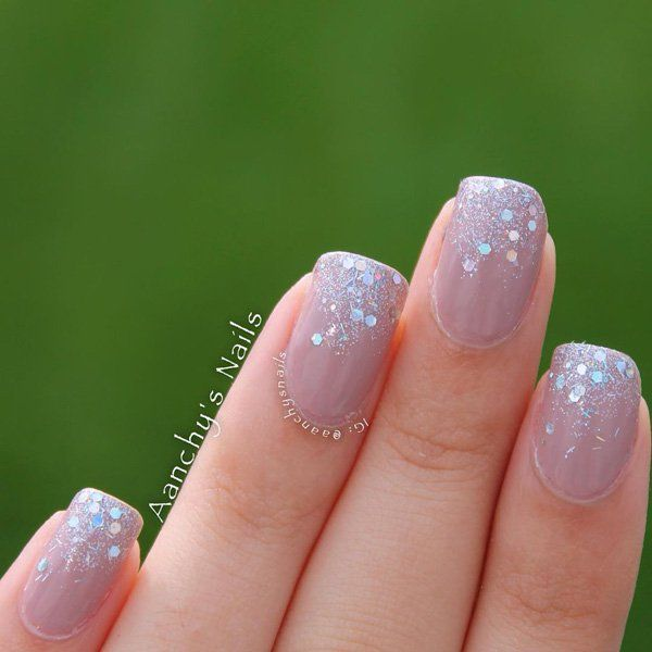Elegant looking French tip in matte nude base and silver dust for the tips.