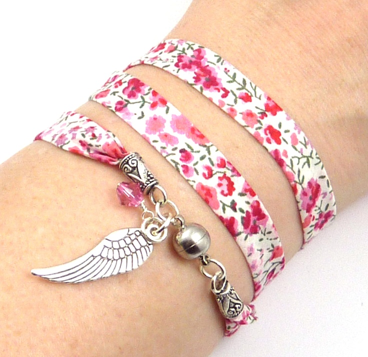 Fun and fashionable, this floral Liberty of London fabric wrap bracelet features an angel wing charm and an pink Swarovski crystal. $28.99