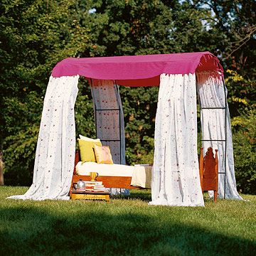 Make a simple garden room with preformed garden arches and outdoor-friendly curtain panels. This getaway sports a bed for mid-day naps, but would also be comfortable with Adirondack chairs or a cafe table set for elegant picnics.