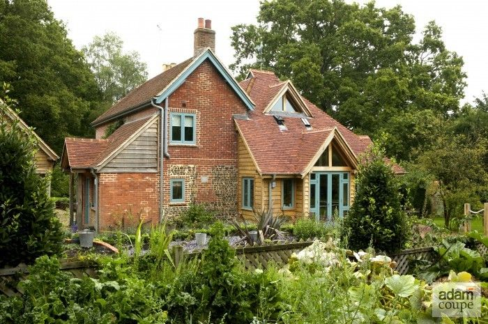 Beautiful old cottage with oak frame extension surrounded by a lovely garden...love it!