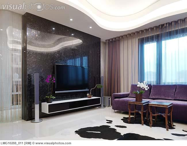 cowhide rug for modern living room with purple sofa and flat screen tv images